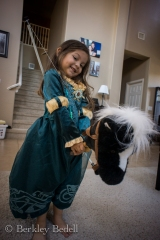Merida (Ellie), Angus the horse, and her bow.