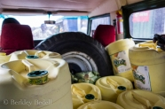 When we travel to the market, we carry empty jugs with us - filled in the photo - that we fill with water to use for cooking and cleaning